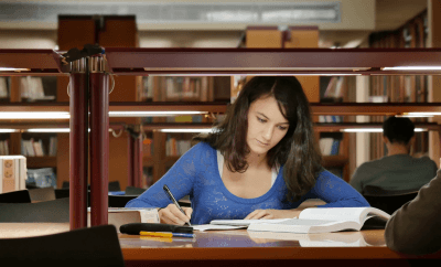 Student studying at Library For Final Exams