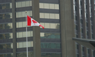 Canadian Flag Flying in Front of Office Building