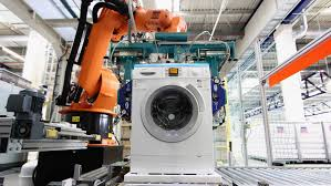 A robot assembling washing machines in a factory.